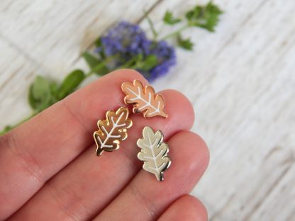 mini leaf pins on hand, to show size of 15mm